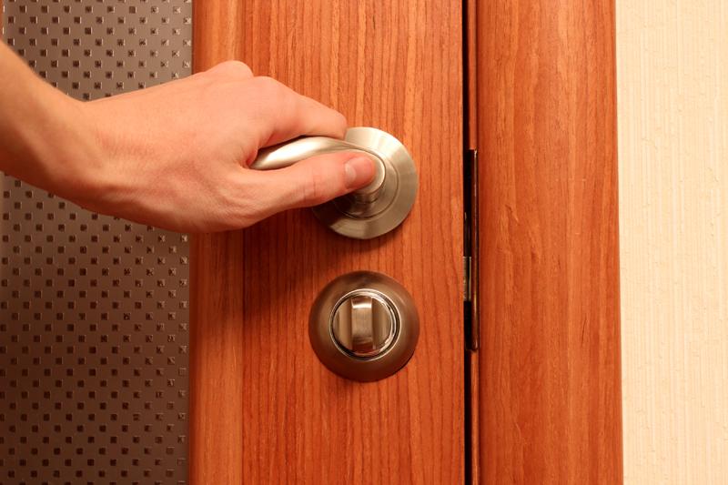The hand opening a door