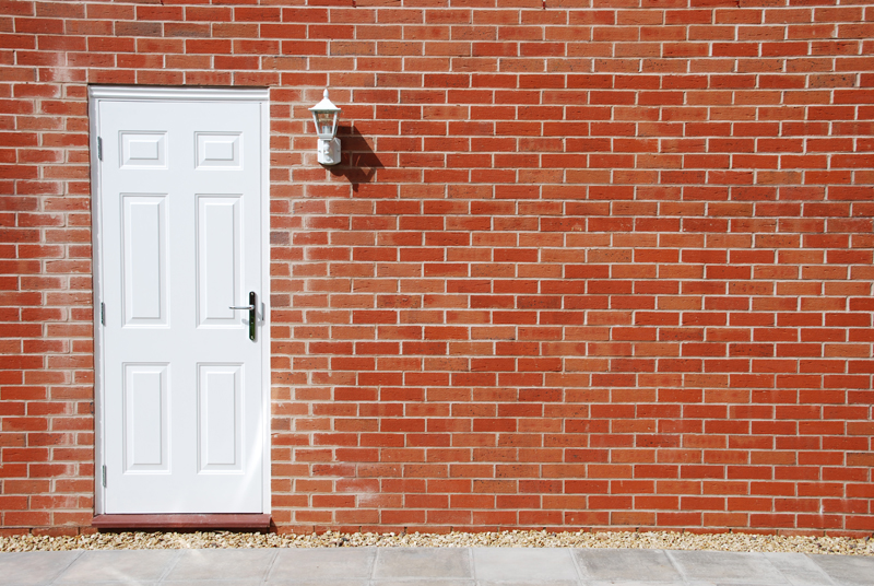 White door on a brick wall